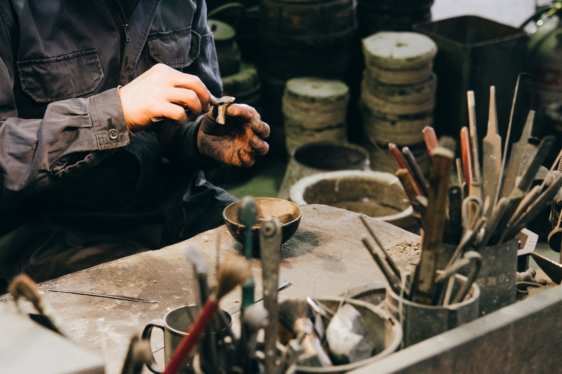 A craftman working on creating a bowl